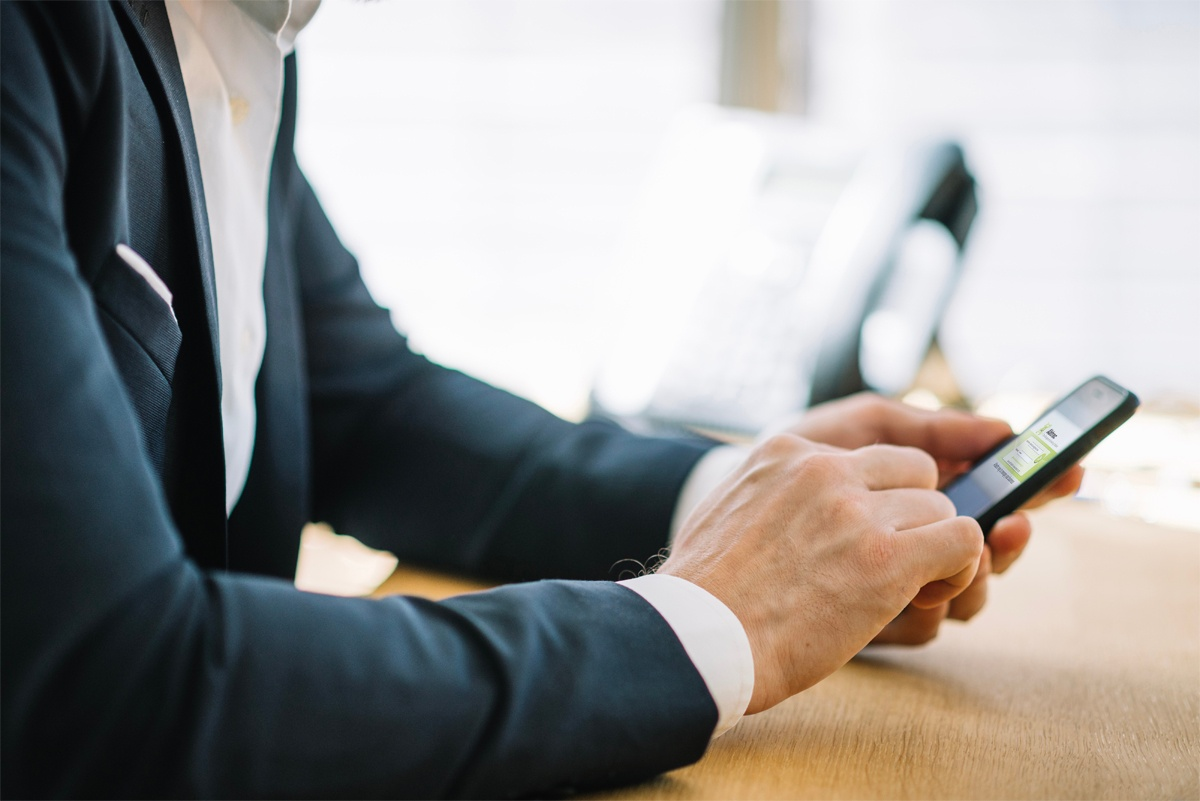 Businessman using Abtrac on smartphone