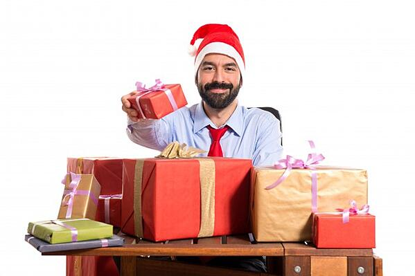 christmas-man-in-his-office-with-several-gifts_1368-4685
